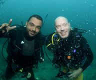 Two friends scuba diving Stock Images