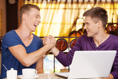Two friends shaking each other hands. Stock Image
