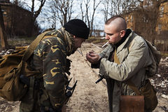 Two friends sharing smoke and getting ready to start fighting Stock Images