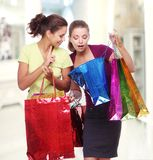 Two friends with shopping. Royalty Free Stock Images