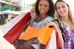 Two friends with shopping bags. Two friends with their shopping bags royalty free stock photo