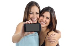 Two friends showing a blank smart phone screen Royalty Free Stock Photography