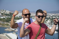 Two friends showing off his muscles Royalty Free Stock Photo