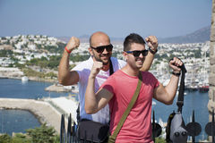 Two friends showing off his muscles Stock Image