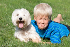 Two friends with shut eyes and tongues out Royalty Free Stock Image