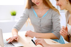 Two friends or sisters making on line shopping by credit card Royalty Free Stock Photography