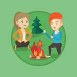 Two friends sitting around bonfire in camping. Royalty Free Stock Photo