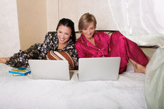 Two friends sitting at the laptops Stock Photos