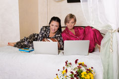 Two friends sitting at the laptops Royalty Free Stock Image