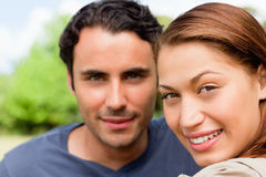 Two friends smiling as the look ahead Stock Image