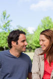 Two friends smiling as they look into each others eyes Royalty Free Stock Images