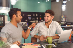 Two friends spending time in cafe Royalty Free Stock Photos