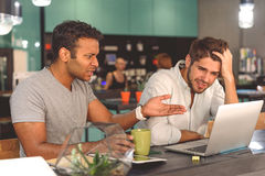 Two friends spending time in cafe Stock Image