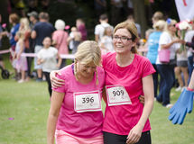 Two friends st the end of race for life. Royalty Free Stock Photo