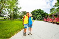 Two friends stand close to each other in park Royalty Free Stock Image
