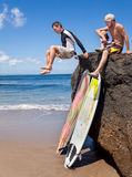 Two friends surfer on rock Royalty Free Stock Photos