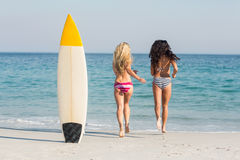 Two friends in swimsuits Stock Images