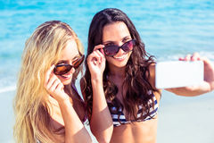 Two friends in swimsuits taking a selfie Stock Image