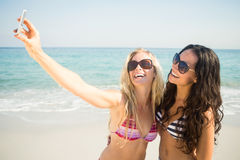 two friends in swimsuits taking a selfie Stock Photo