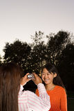 Two friends taking a photograph Royalty Free Stock Images