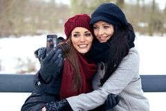 Two Friends Taking Picture of Themselves Royalty Free Stock Image