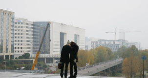 Two friends taking selfie. PARIS, FRANCE - CIRCA 2015: Two friends taking paired selfies and laughing after sharing photo in La Defense Business district, under stock video