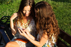 Two friends taking selfie by smartphone Royalty Free Stock Photo