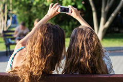 Two friends taking selfie by smartphone Stock Image