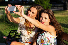 Two friends taking selfie by smartphone Stock Images