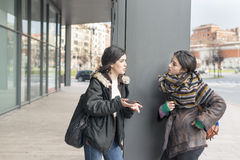 Two friends talking in the street. Stock Photography