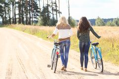 Two friends during their bike walking outdoors Royalty Free Stock Photos