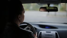 Two friends are traveling by car. Two women travel by car through the road. stock video footage