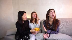 Friendly female friends offer bad food to friend on diet. Two friends urge woman to eat bad food. girl is on diet. concept of healthy intuitive nutrition, fast stock video