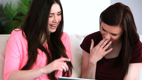 Two friends using a digital tablet stock video footage