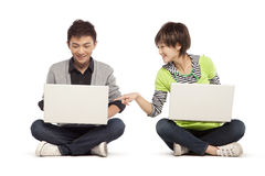 Two friends using laptop computers Stock Image