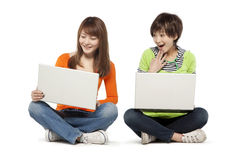Two friends using laptop computers Royalty Free Stock Photo