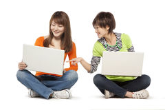 Two friends using laptop computers Royalty Free Stock Images