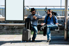 Two friends are waiting and getting mad because of the delay. Stock Image