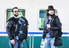 Two friends are waiting for the train to come Stock Image