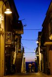 Blue hour alley. Two friends walking in alley at night royalty free stock photography