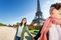 Two friends walking around Paris holding hands Stock Photo