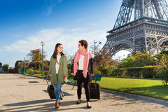 Two friends walking around Paris with luggage Stock Photo