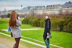 Two friends walking taking pictures of each other Stock Photos