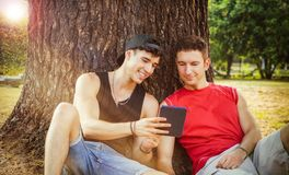 Two friends watching something on tablet or ebook Royalty Free Stock Photo