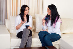 Two friends women conversation home Royalty Free Stock Photo