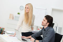 Two friends working in the office Royalty Free Stock Image