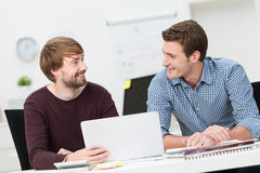 Two friends working together in the office Royalty Free Stock Image