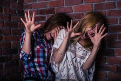 Two frightened woman Royalty Free Stock Images
