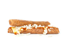 Two frikandellen speciaal, a Dutch fast food snack. With mayonnaise, curry sauce and chopped onions stock images