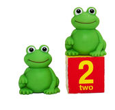 Two frogs. Toys: two small frogs isolated Royalty Free Stock Photography